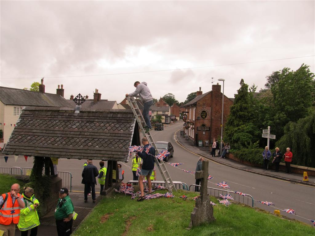 Members of Wymeswold Running Club put up the bunting