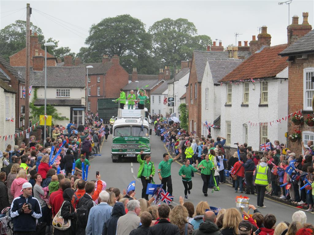 Crowds greet the various sponsor vehicles