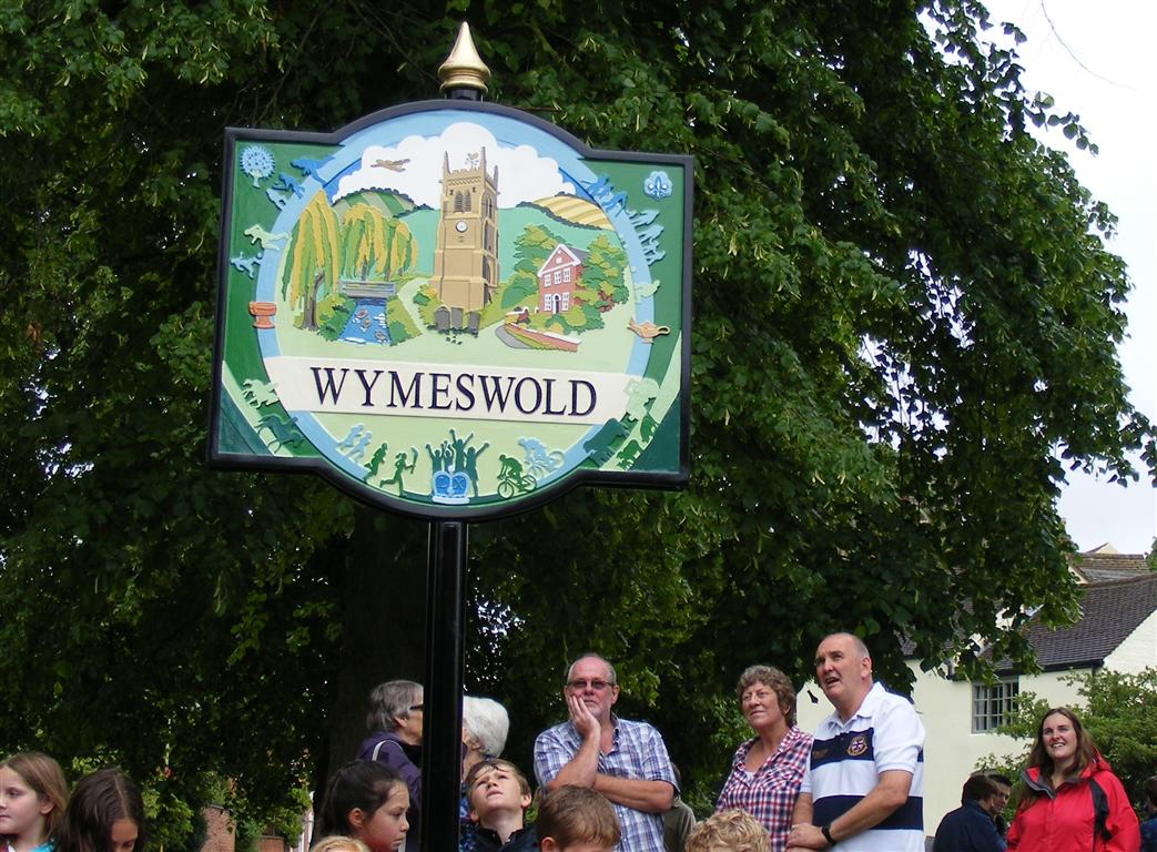 Villagers admire the new sign